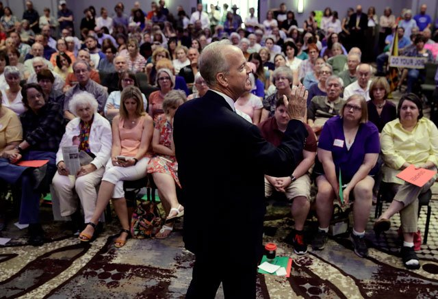 Sen. Jerry Moran, R-Kansas, addresses a crowd of several hundred during a town hall meeting Monday, June 12, 2017, in Lenexa, Kan. (AP Photo/Charlie Riedel)