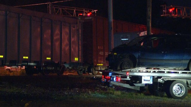 Police say one person was hurt when the blue minivan drove into the train. (KCTV5)