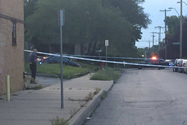 Police say the suspect fled the scene and is described as a white man wearing all purple and armed with a hunting knife. (KCTV5)