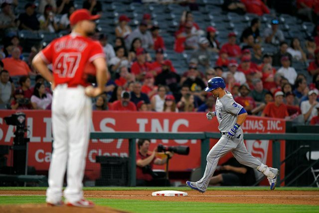 Cain hit a line drive that barely cleared the wall in left center in the third inning, and Gordon followed it up with a shot to center in the fourth, his third of the year. (AP)
