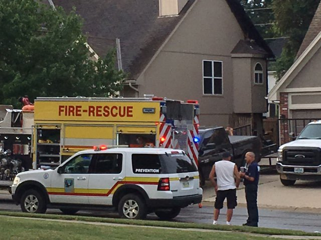 Six adults, a baby and one other dog were able to safely evacuate the home. (KCTV5)