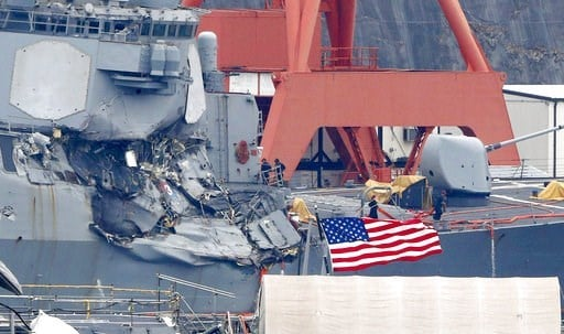 (Kyodo News via AP). Damaged USS Fitzgerald is seen at Yokosuka Naval Base, south of Tokyo, Sunday, June 18, 2017.