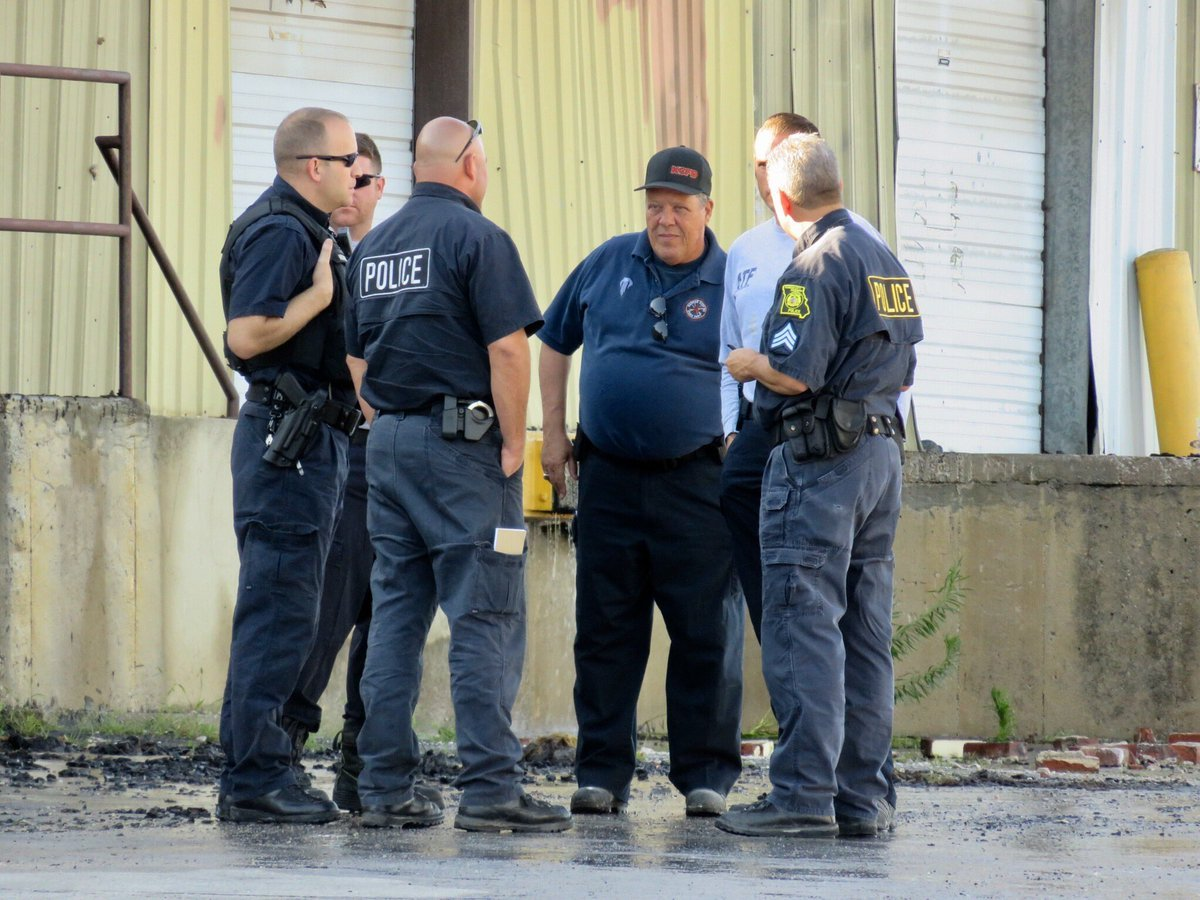 Fire investigators gather at Fridays Only Furniture Outlet. (Rob Rhodes/KCTV5 News)