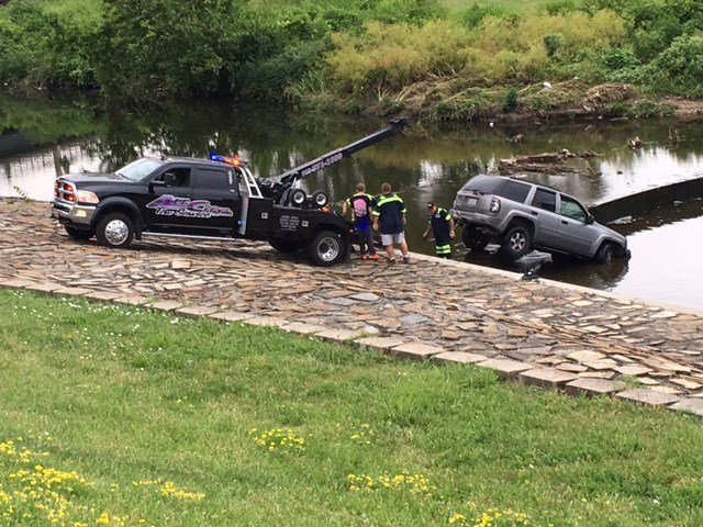 A tow truck pulled the vehicle out of the creek. (KCTV5)