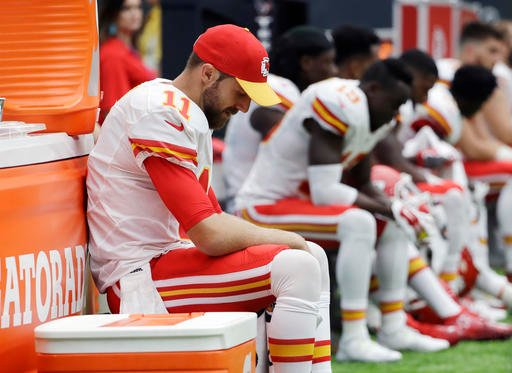 FILE - In this Sept. 18, 2016, file photo, Kansas City Chiefs quarterback Alex Smith (11) sits on the sideline during the second half of an NFL football game against the Houston Texans. (AP Photo/David J. Phillip, File)