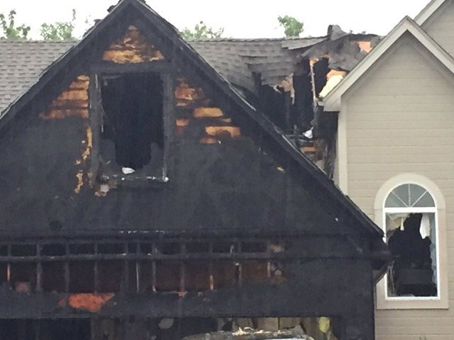 Fire crews say the home was heavily damaged. (KCTV5)