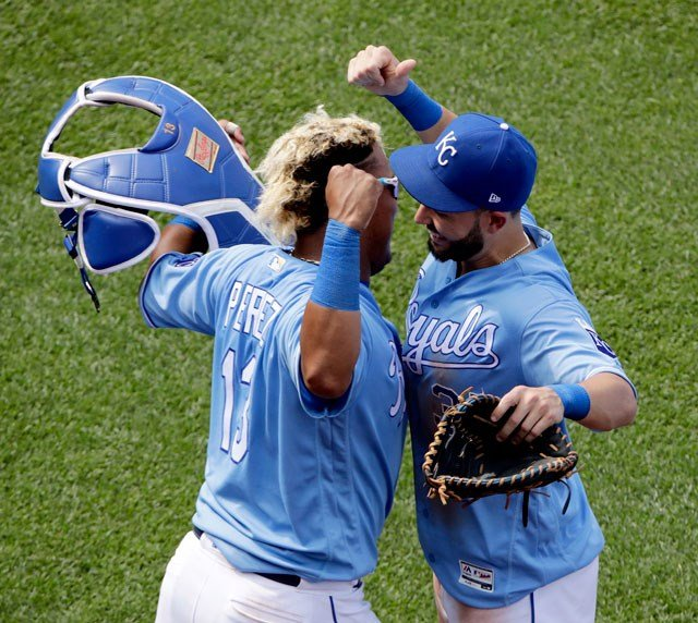 Kansas City Royals' Salvador Perez, left, and Eric Hosmer celebrate after the Royals' baseball game against the Boston Red Sox on Wednesday, June 21, 2017, in Kansas City, Mo. The Royals won 6-4. (AP Photo/Charlie Riedel)