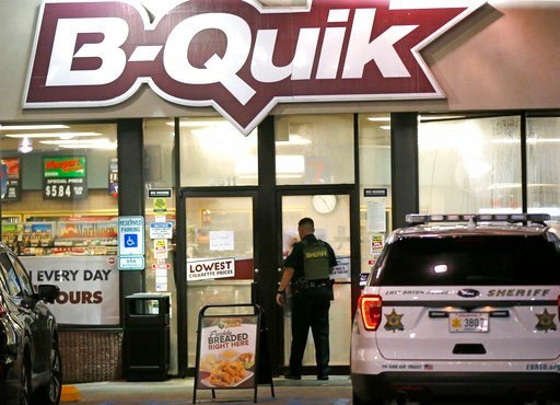 (AP Photo/Gerald Herbert, File). FILE - In this July 17, 2016 file photo, an East Baton Rouge Sheriff's officer enters the B-Quick convenience store at the shooting scene in Baton Rouge, La.