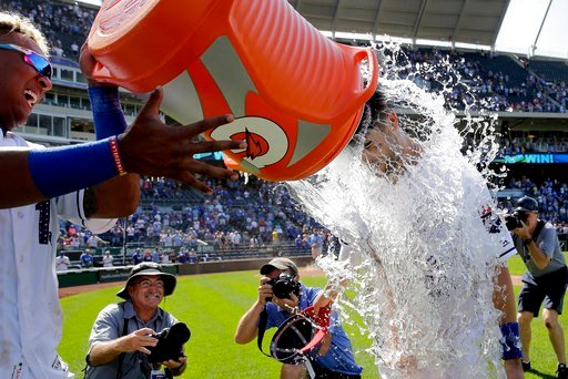Kansas City Royals' Whit Merrifield is doused by Royals' Salvador Perez after a baseball game against the Minnesota Twins, Sunday, July 2, 2017, in Kansas City, Mo. (AP Photo/Charlie Riedel)