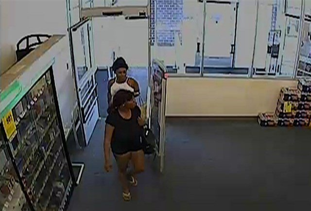 Two of the suspects are shown in a surveillance photograph and are believed to be black women in their late teens to early 20's. (KCTV5)