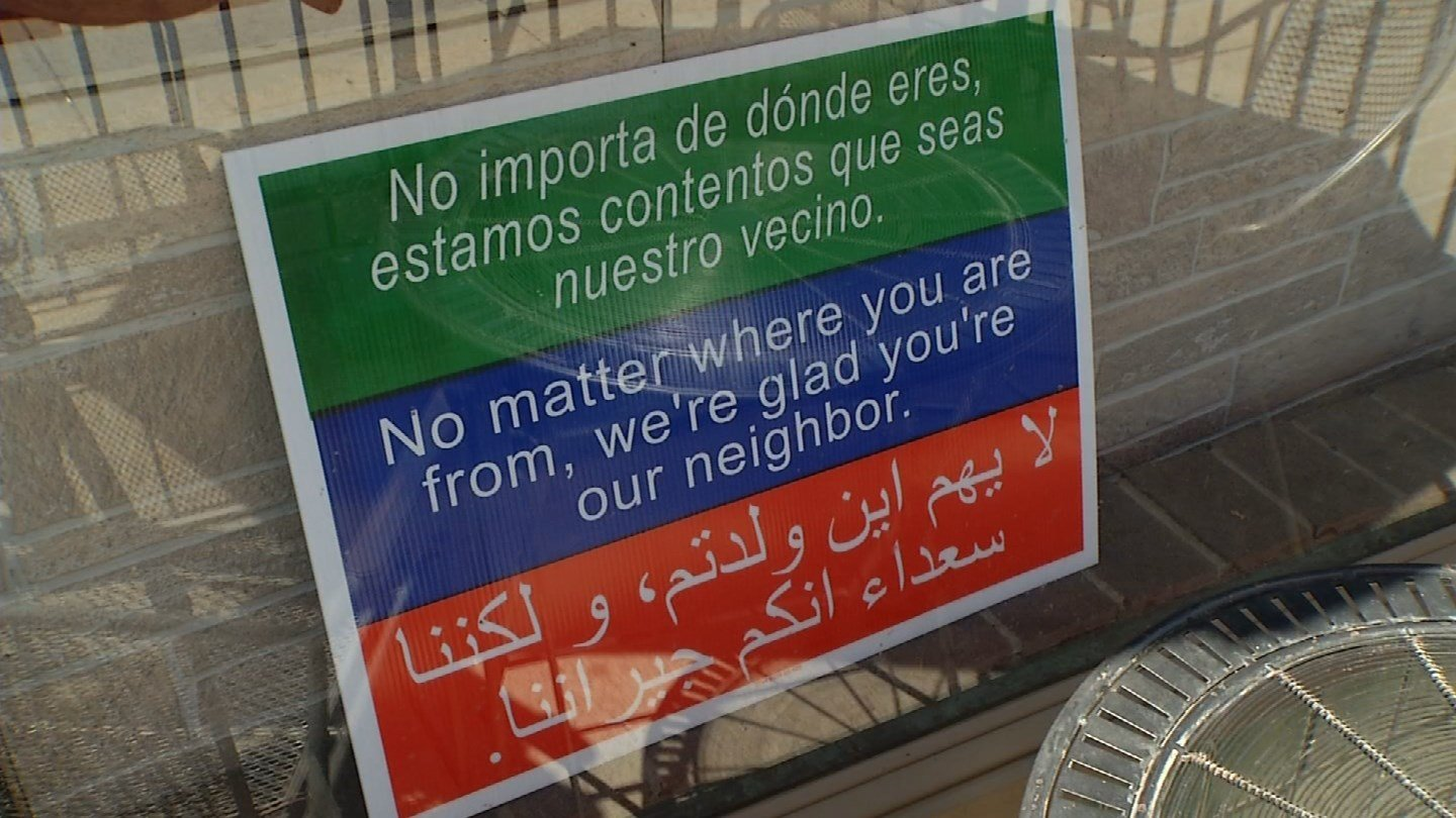 "A sign has long sat in the window at the Aladdin Cafe on Massachusetts Street reads ""No matter where you are from, we're glad you're our neighbor."" (KCTV5)"