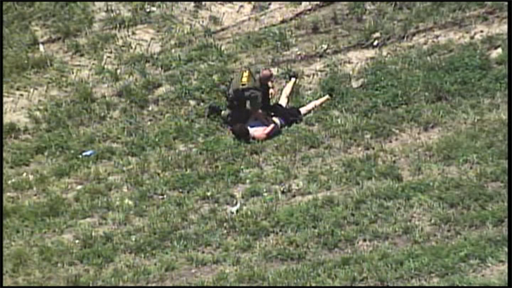 A deputy taking one of the suspects into custody after a short chase on foot. (KCTV)