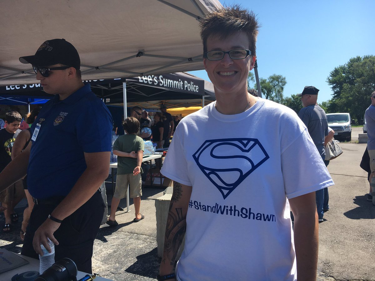 "Some bought shirts saying ""#StandWithShawn"" on the front and ""No One Fights Alone"" on the back. (KCTV/Ashley Arnold)"