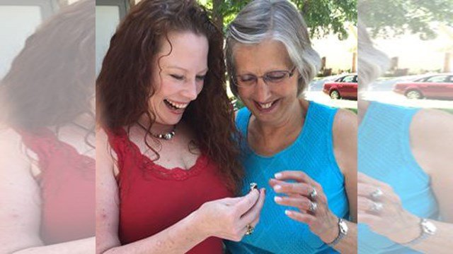 Julie Merckling (left) is reunited with her ring. (Submitted to KCTV)