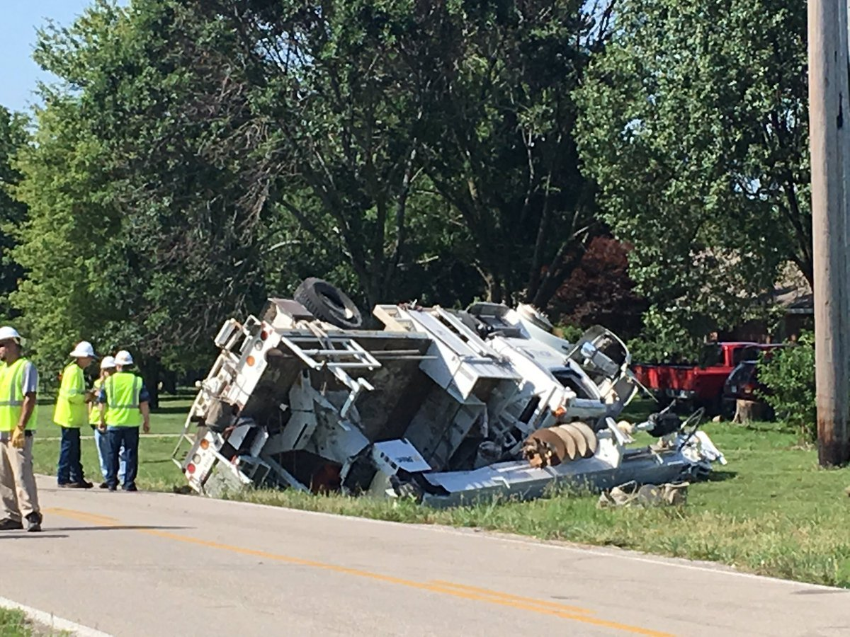 A Kansas City Power and Light employee was injured after his truck flipped over multiple times off Mission Road. (KCTV5)