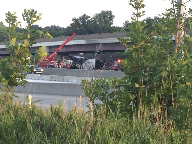 Crews are using a crane to move the semi. (KCTV5)