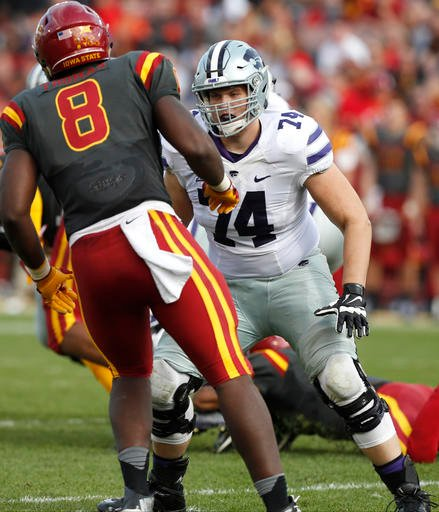 Kansas State offensive lineman Scott Frantz, right, looks to block Iowa State defensive end Jhaustin Thomas (8) during the second half of an NCAA college football game, Saturday, Oct. 29, 2016. (AP)