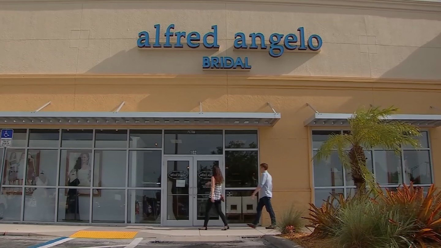 Natalie M., a store specializing in wedding and prom dresses and suits, has had several brides order Alfred Angelo dresses, but now that the designer has filed for bankruptcy, the brides are furious. (CBS)