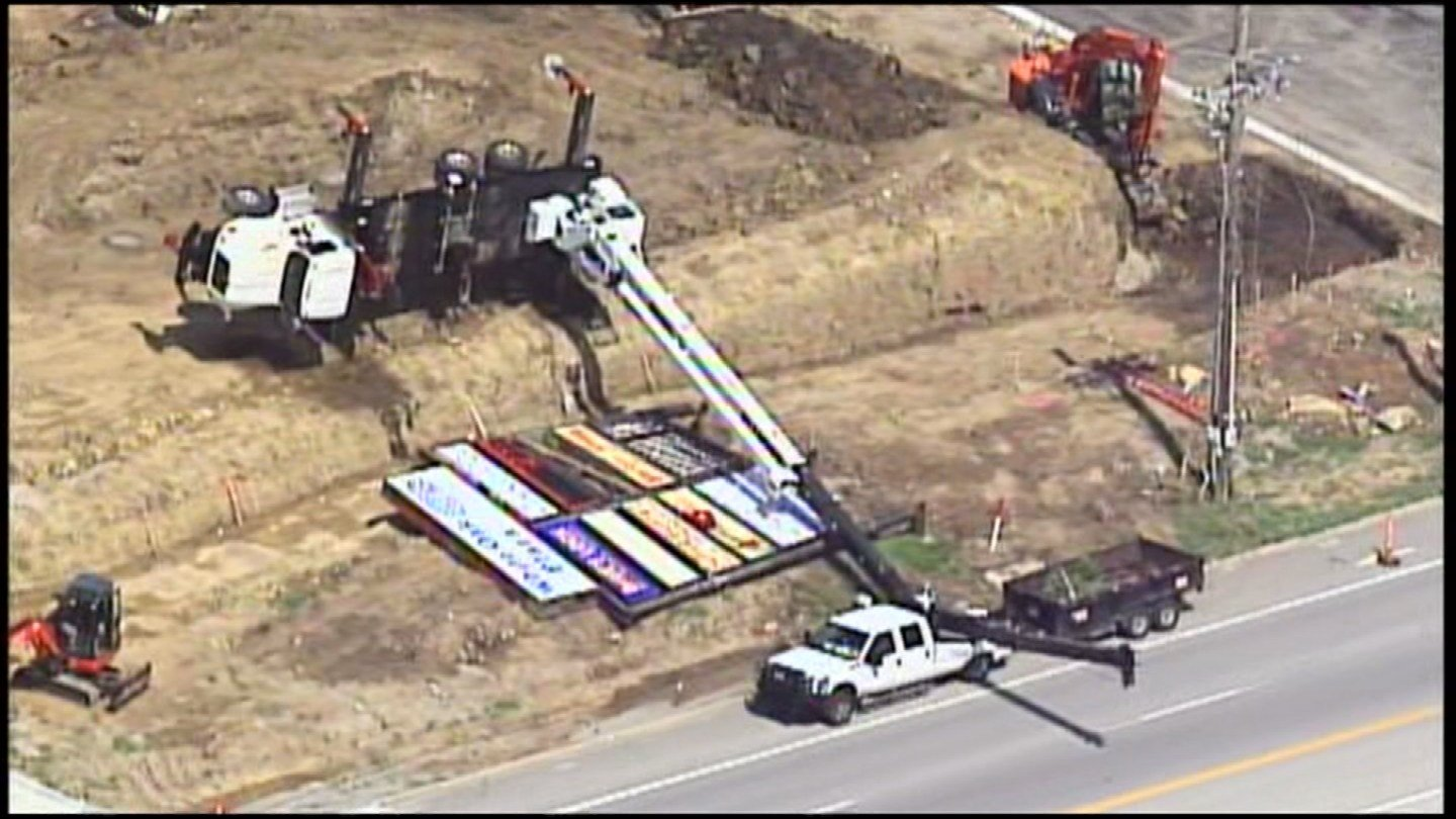 A crane tipped over in Blue Springs leaving one man hurt.  One of the stabilizing outriggers began to sink in the dirt, and that's when it started to tip. (KCTV5)