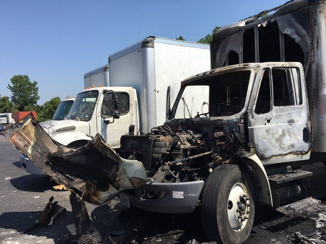 Owners found their trucks spray-painted with racial slurs. One of the trucks was even torched. (KCTV5)