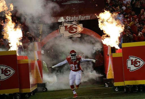 Chiefs outside linebacker Tamba Hali (91) takes the field for introduction before an NFL divisional playoff football game between the Kansas City Chiefs and the Pittsburgh Steelers Sunday, Jan. 15, 2017, in Kansas City, Mo. (AP Photo/Charlie Riedel)