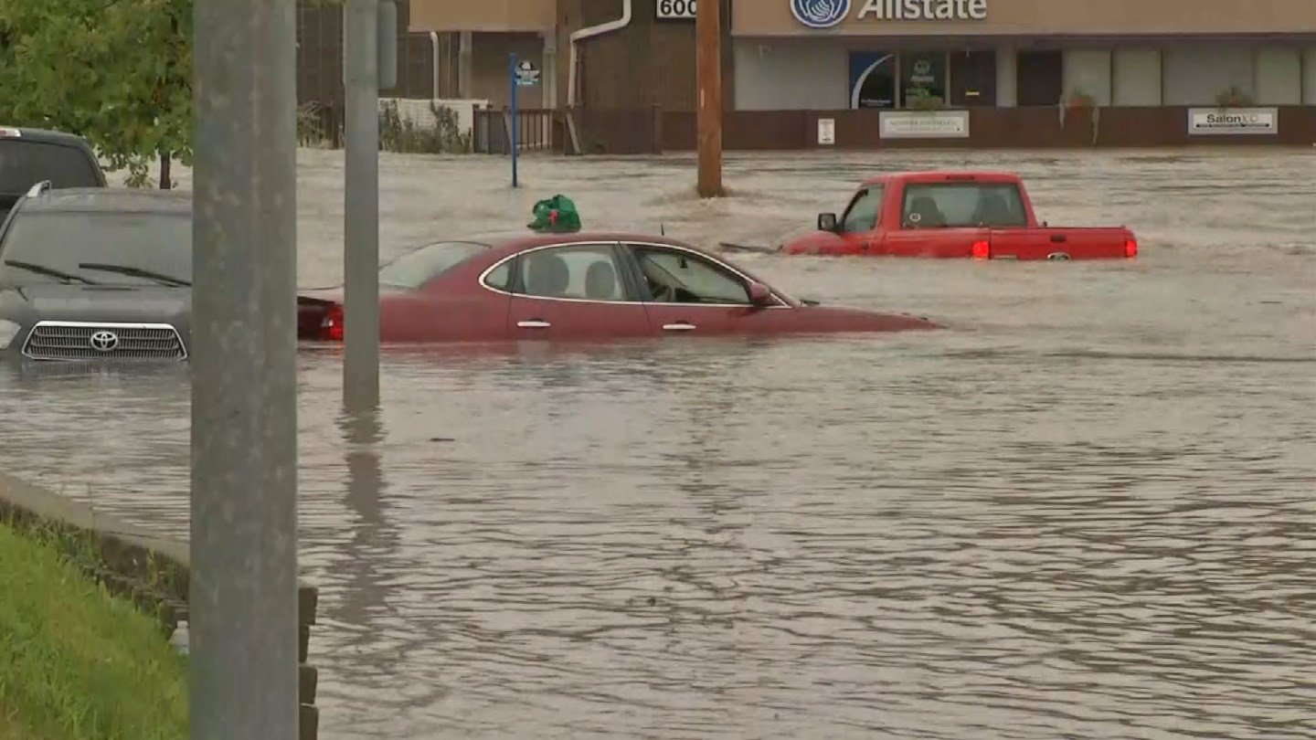 Heavy rains across the Kansas City area have closed roads and led to numerous water rescues. (AP)