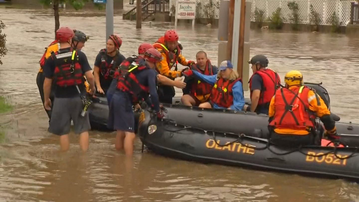 Firefighters have rescued two co-owners of Coach's who were stuck inside the restaurant during the rising waters of Indian Creek. (KCTV5)