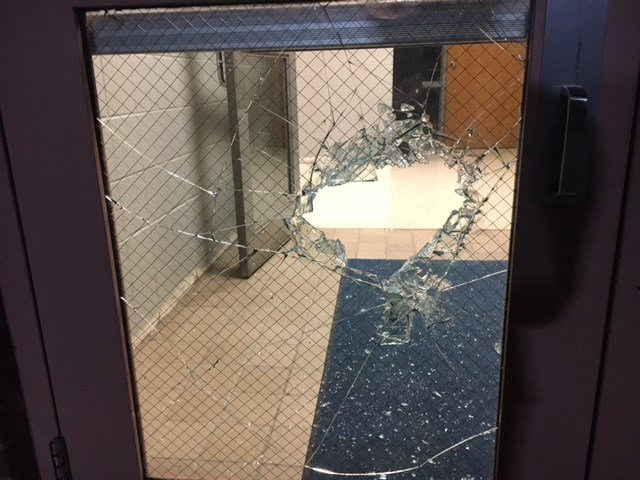 Police say the kids threw a rock through one of the school's doors and went inside. (KCTV5)