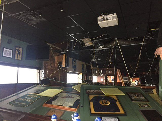 Water moved inside, causing widespread damage and trapping the establishment's owners inside. (KCTV5)