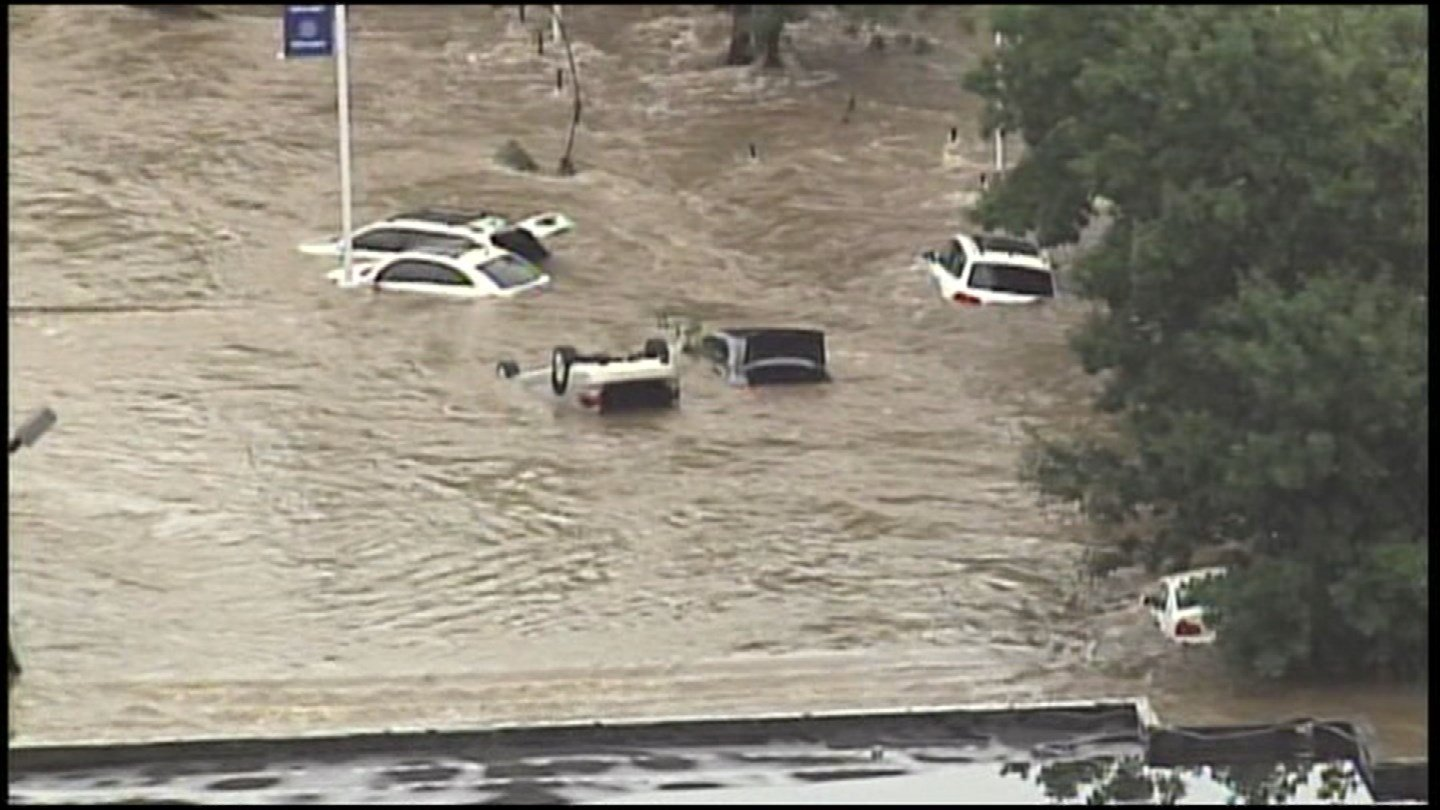 A car doesn't have to be underwater to be damaged and totaled by flood water. Even water covering just about half of the tires is enough to ruin it. (KCTV5)