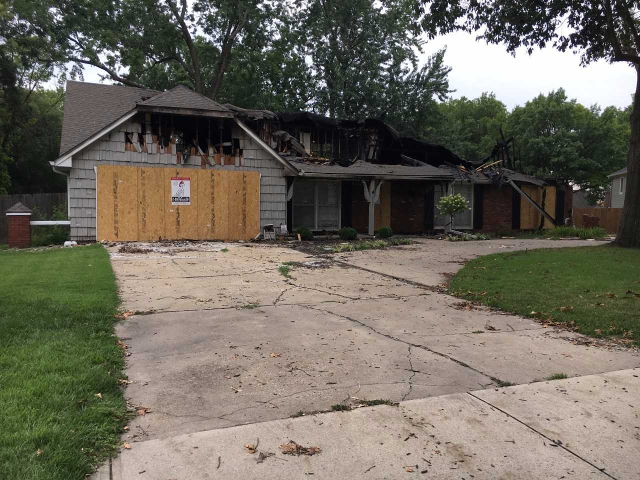 Flames engulfed a home in Prairie Village on Sunday morning. (Natalie Davis)