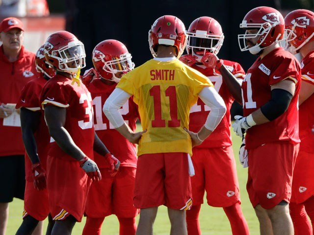 Kansas City Chiefs quarterback Alex Smith (11) talks to the offense during NFL football training camp Saturday, July 29, 2017, in St. Joseph, Mo. (AP Photo/Charlie Riedel)