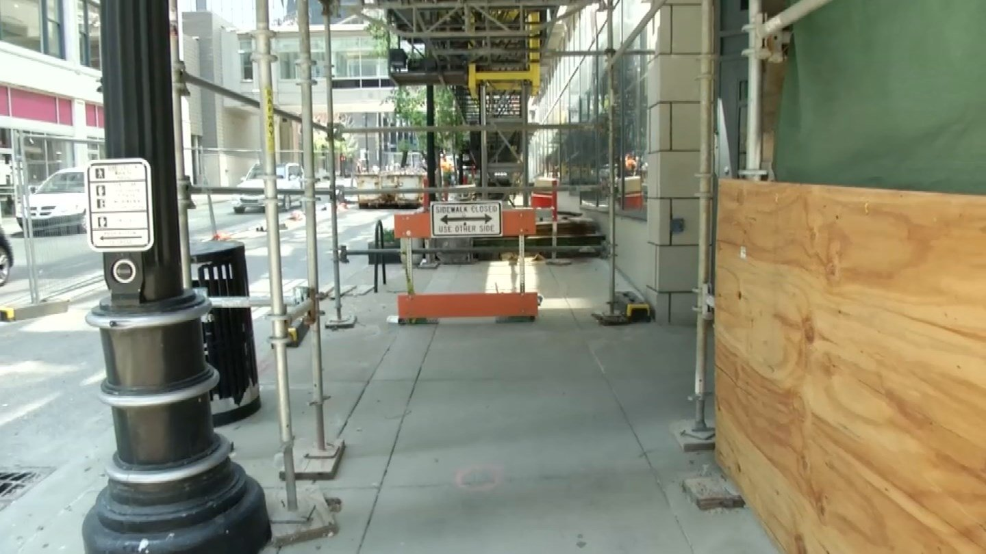 In order for a contractor to do work on a sidewalk in downtown Kansas City, they must pull a permit. And they're given a document that outlines the city's pedestrian detour policy. (KCTV5)