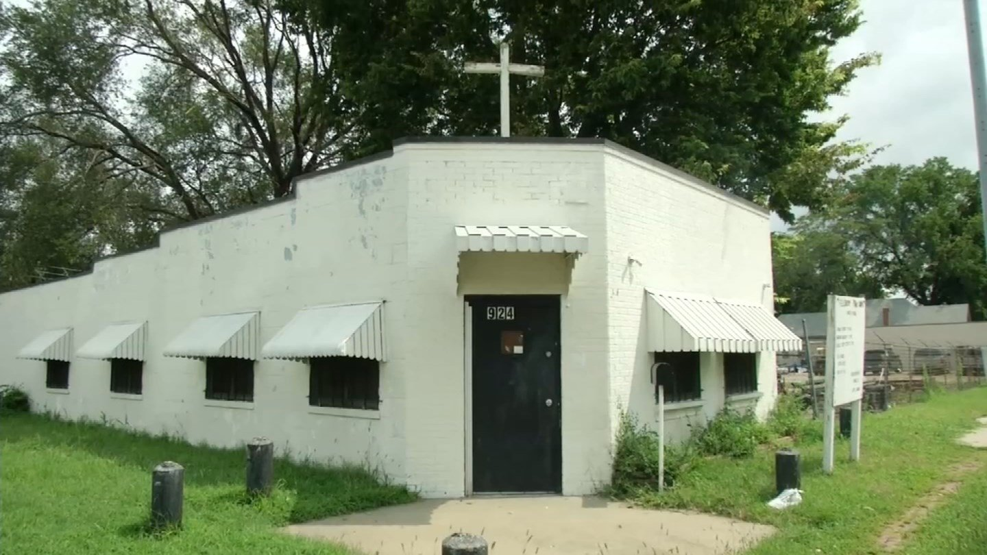A white cross sits at the peak of the small white church on Osage Avenue. Fellowship Prayer Temple has been serving its members for more than 30 years. (KCTV5)