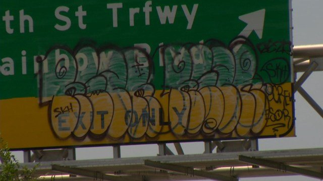 A contractor was brought in to replace the tagged signs and to take down the catwalks and ladders. (KCTV5)