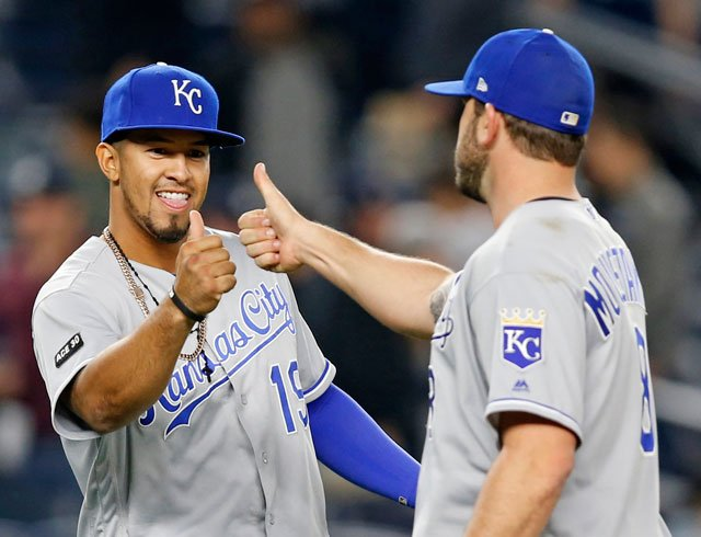 Kansas City Royals' Cheslor Cuthbert (19) celebrates with Royals third baseman Mike Moustakas (8) after a baseball game against the New York Yankees in New York, Tuesday, May 23, 2017. The Royals defeated the Yankees 6-2. (AP Photo/Kathy Willens)