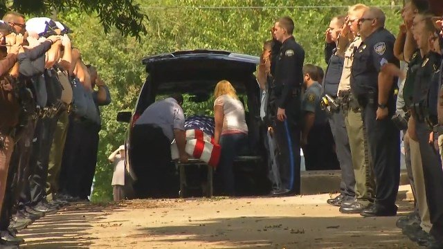 Hearts were heavy in the small town of Clinton on Wednesday as hundreds came out to say goodbye to their fallen hero. (Andrew Zimmerman/KCTV5 News)