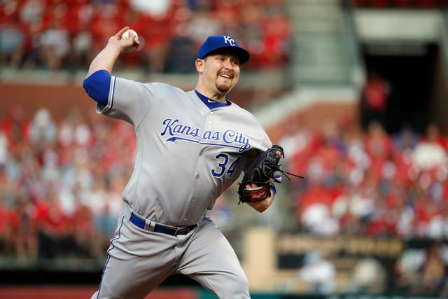 Kansas City Royals starting pitcher Trevor Cahill throws during the first inning of a baseball game against the St. Louis Cardinals Wednesday, Aug. 9, 2017, in St. Louis. (AP Photo/Jeff Roberson)