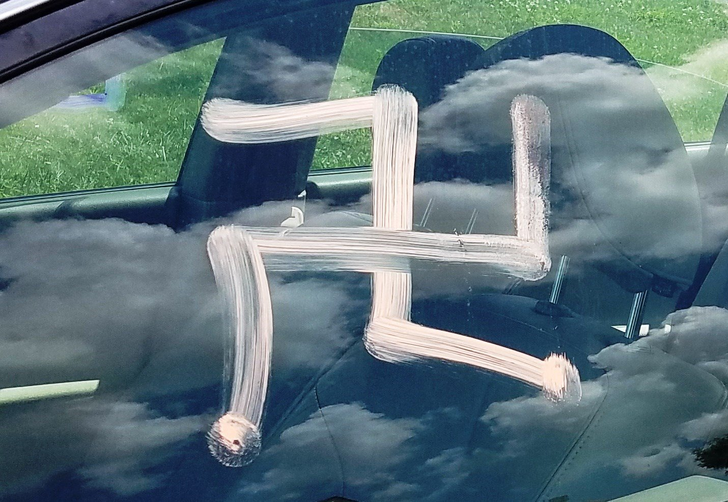 Grain Valley police are seeking help after vandals damaged parked vehicles by writing racial slurs and sexually suggestive drawings. (CrimeStoppers)