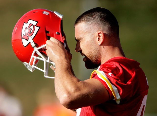 Kansas City Chiefs tight end Travis Kelce (87) puts on his helmet during NFL football training camp Saturday, July 29, 2017, in St. Joseph, Mo. (AP Photo/Charlie Riedel)