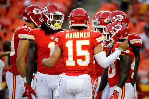 ansas City Chiefs players huddle around quarterback Patrick Mahomes (15) before an NFL preseason football game against the San Francisco 49ers in Kansas City, Mo., Friday, Aug. 11, 2017. (AP Photo/Charlie Riedel)