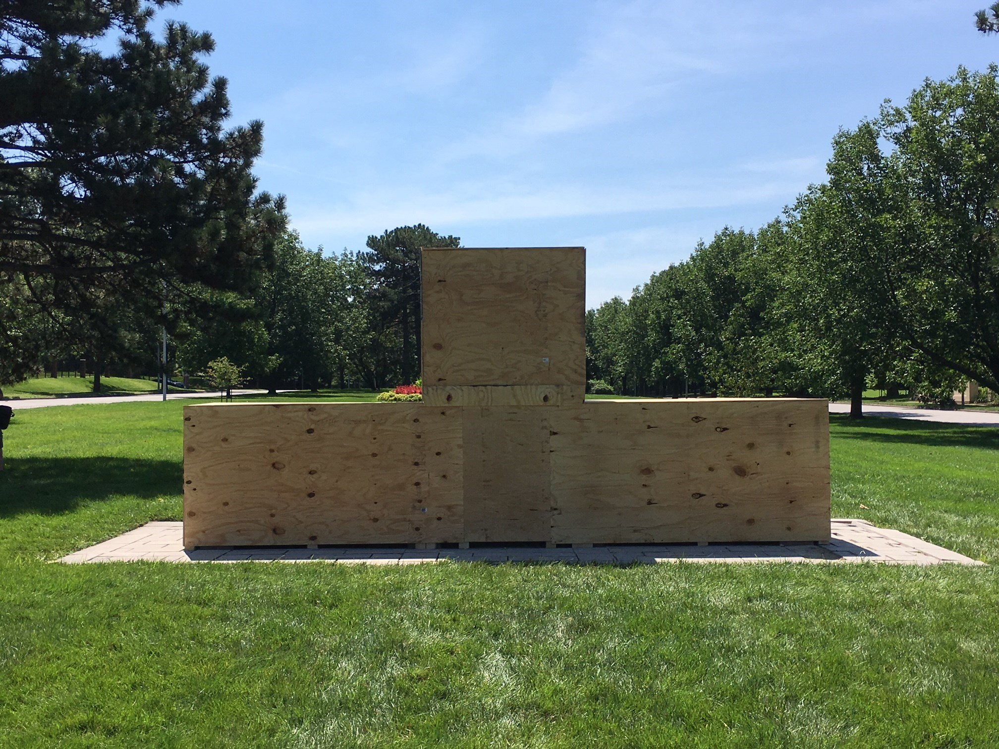 On Sunday, people came and put wood around the entire monument. (Eric Smith/KCTV)