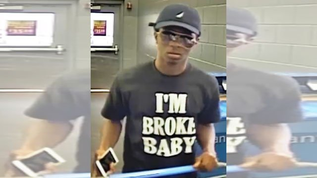 "Police are on the hunt for a man accused of stealing a TV while wearing a T-shirt with the phrase ""I'm Broke Baby"" on it. (Lee's Summit Police Department)"