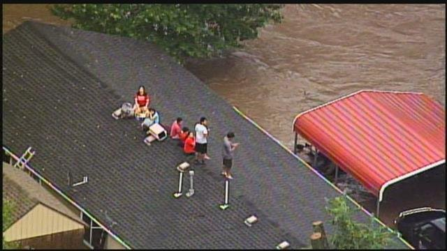 A family was forced onto the roof of their home due to flooding near 155th and Kenneth in Overland Park. (Chopper5)