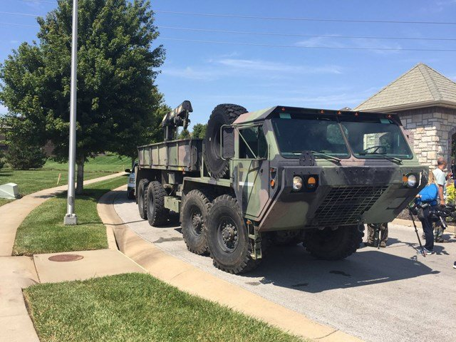 Before rescuers could bring the family to safety, a civilian with a military style APV vehicle was able to evacuate the familysafely, said Jason Rhodes. (KCTV5)