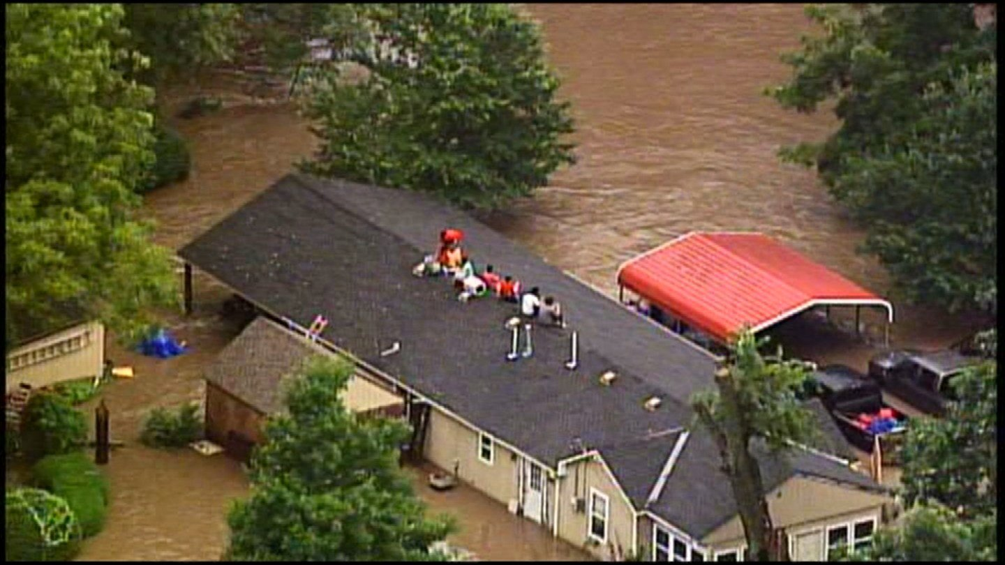 An Overland Park family had to escape rising floodwaters by climbing to their roof and wait for help. (KCTV5)