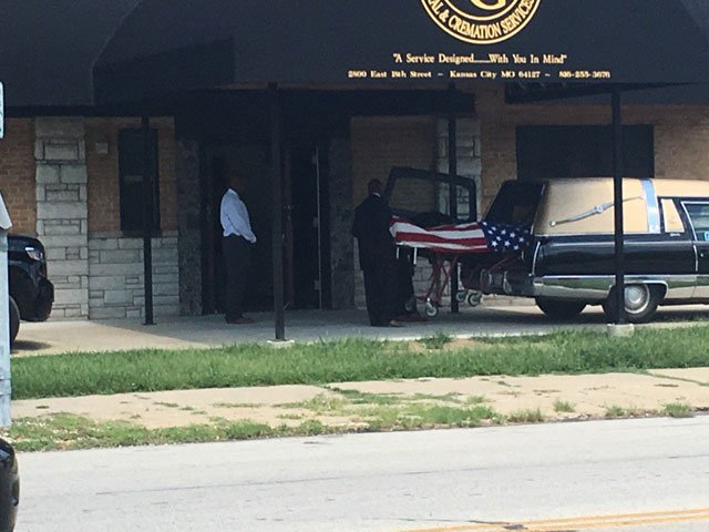 Orr's body was draped with an Americanflag as they carefully moved him inside. (Natalie Davis/KCTV5 News)