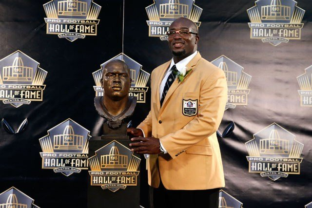 Former NFL player Will Shields poses with his bust during an induction ceremony at the Pro Football Hall of Fame Saturday, Aug. 8, 2015, in Canton, Ohio. (AP Photo/Gene J. Puskar)