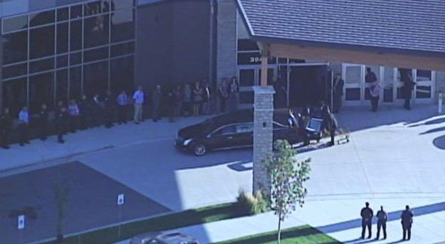 Lee's Summit police officers escorted Orr's body to Abundant Life Church. (KCTV5)