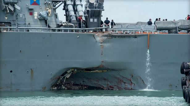 Damage to the portside of the guided-missile destroyer USS John S. McCain. (GETTY IMAGES)